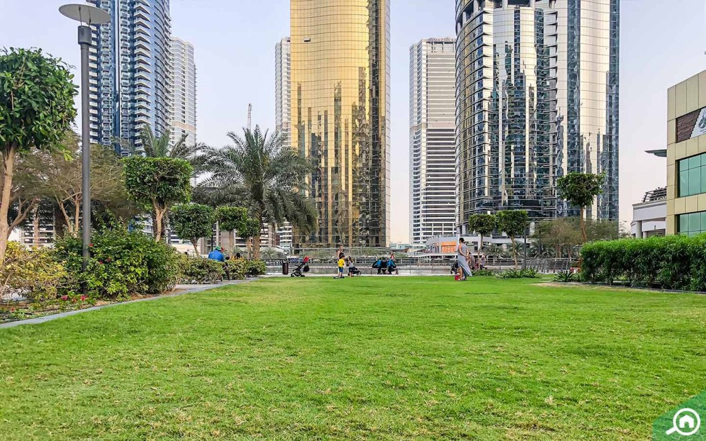 Relax in the park at Jumeirah Lakes Towers (JLT).