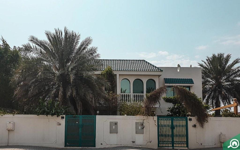 teal-roof houses in Al Shahba