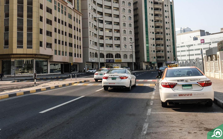 Taxis near Buildings in Al Nud