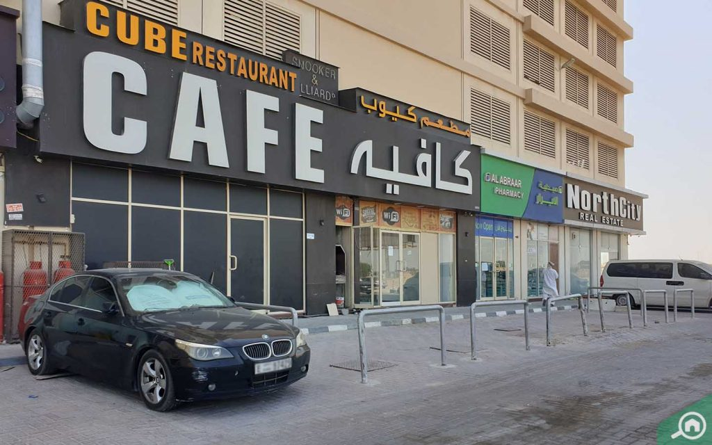 outside view of cube cafe in lavender tower ajman