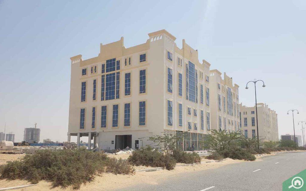 Apartment buildings in Al Ameera Village